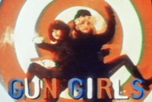 Gun Girls title, with two gun girls on target background